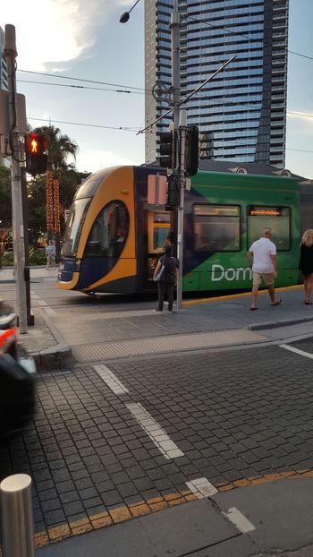Surfers Paradise, Australia Tram City Building Exterior Architecture Outdoors City Life Sky Land Vehicle Built Structure Day Adults Only Tree People Adult