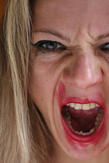 Close-up portrait of mid adult woman screaming