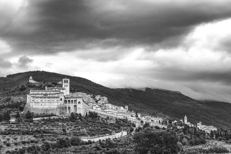 View of assisi against cloudy sky