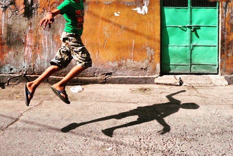 The jump of joy , childhood freedom, Jodhpur, India Sunlight Human Leg Real People One Person Lifestyles Shadows & Lights Streetphotography Streetphoto_color Green Jumping Jodhpur Rajasthan Freedoom  Joy Of Life Sonyalpha Innocence Finding New Frontiers