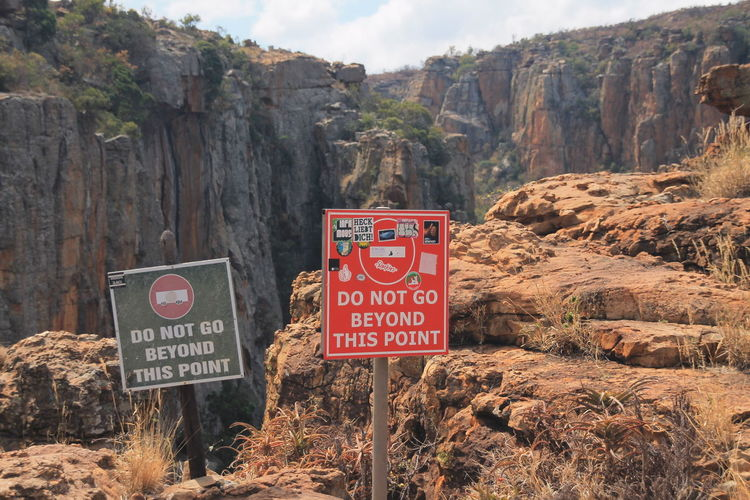 Sign board on rock formations