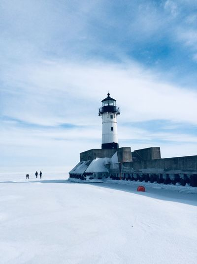 Lighthouse on frozen lake
