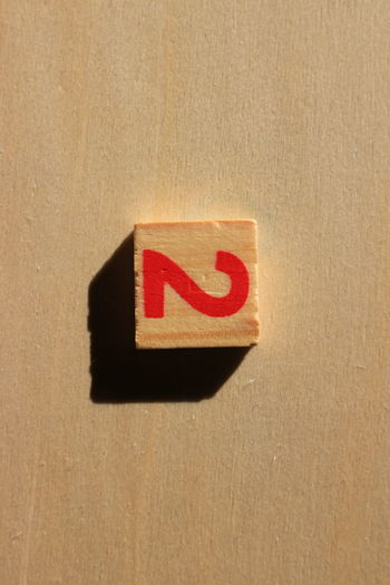Sign Sunlight Wood Beige Background Brown Cardboard Box Close-up Day Education Hardlight Indoors  Learn Mathematics No People Number Numeric Red Shadow Two
