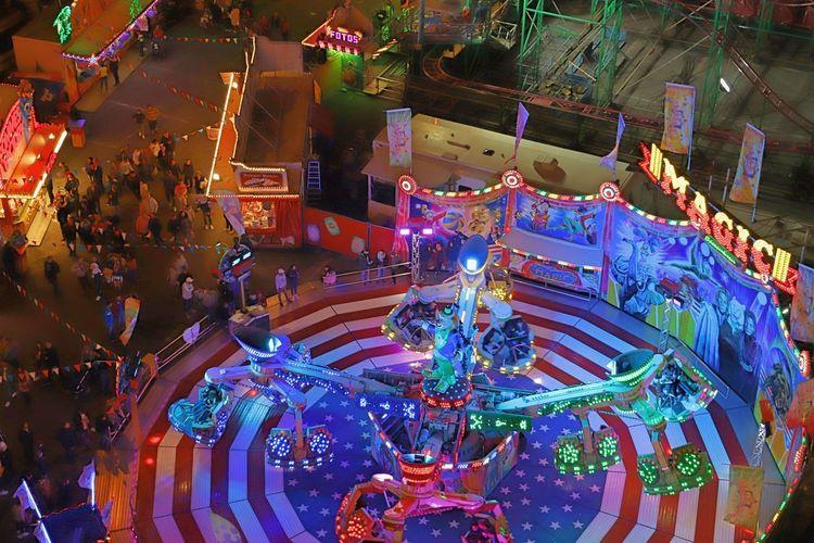 Jahrmarkt Amusement Park Amusement Park Ride Arts Culture And Entertainment Carousel Enjoyment Festival Fun High Angle View Illuminated Leisure Activity Multi Colored Night Representation