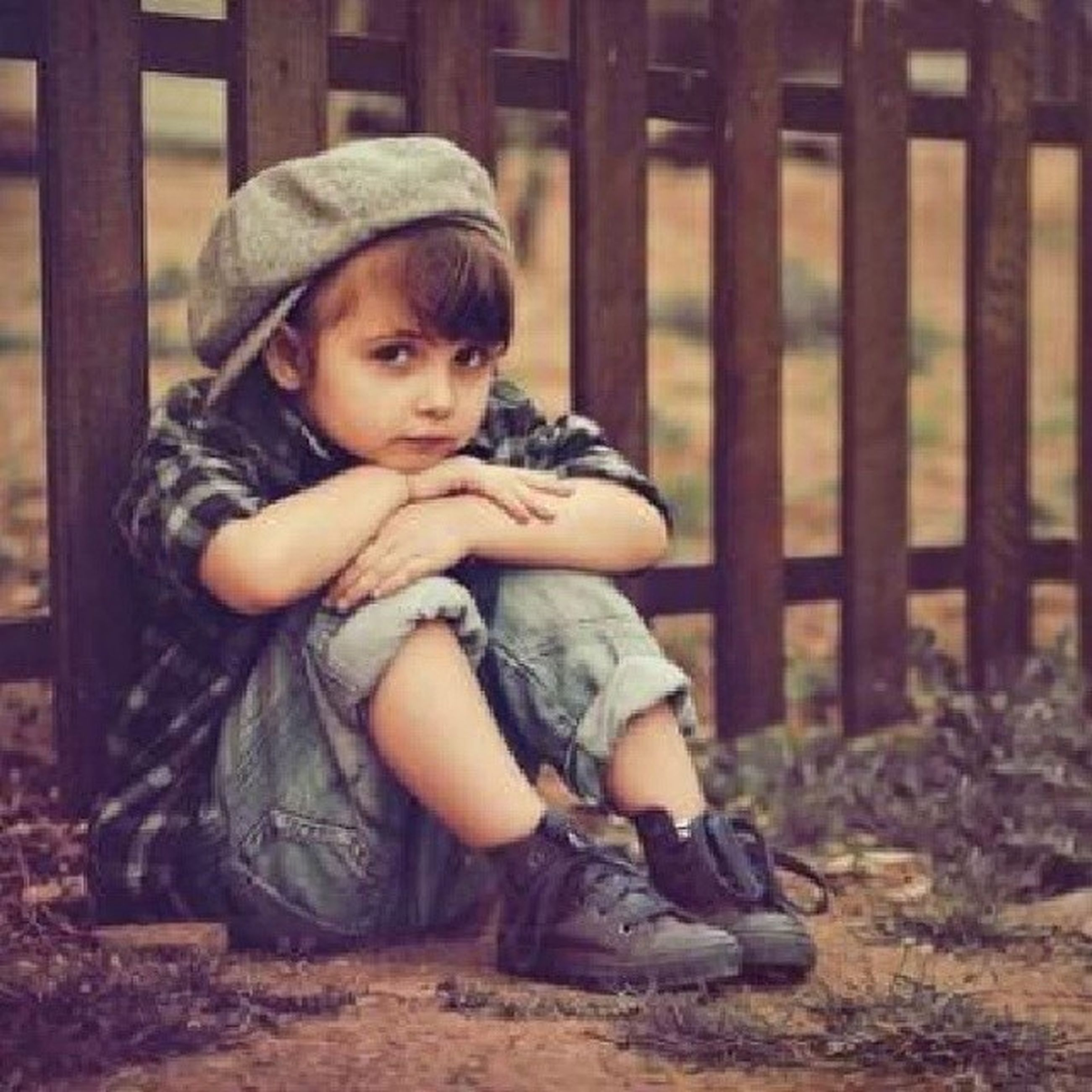 person, casual clothing, childhood, lifestyles, sitting, full length, leisure activity, elementary age, boys, relaxation, young adult, three quarter length, looking at camera, portrait, innocence, bonding, togetherness, young men