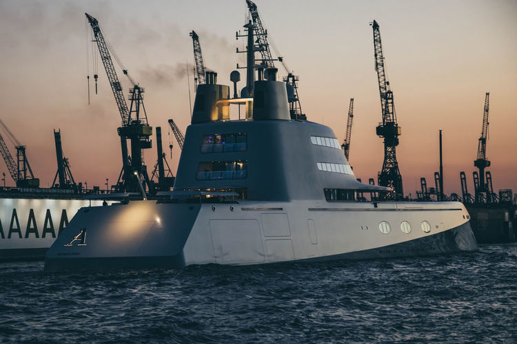"""The """"atomic"""" boat by www.eightTWOeightSIX.de Boat Ship Hamburg Crane Waterfront Industry Commercial Dock Harbor Cloud Water Shipping  Sky Outdoors Yacht Billionaire  Rich Money Sunset Night River Hamburg Harbour Elbe Evening Hamburger Hafen Germany Mobility In Mega Cities"""