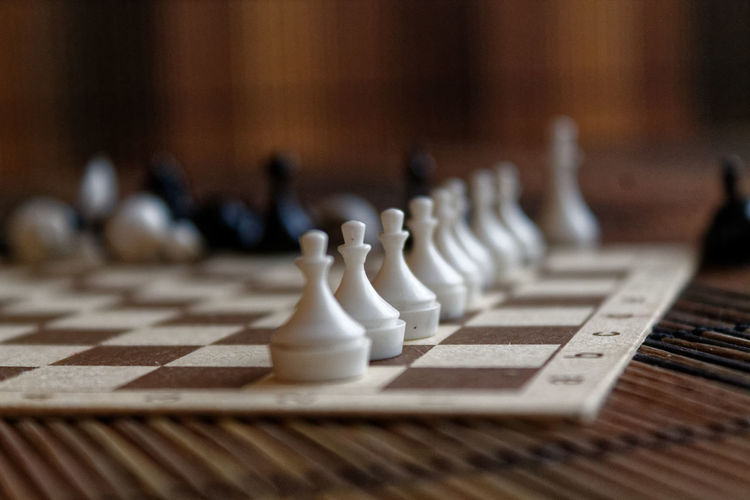 Close-up of chess pieces on place mat