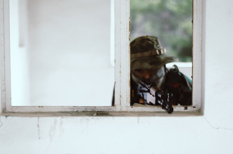 Special forces soldier holding rifle gun aim window white frame cover Window Domestic Domestic Animals Pets Mammal Animal Themes Animal Glass - Material Day Transparent No People One Animal Vertebrate Canine Architecture Outdoors Dog Reflection Window Frame Airsoft Sniper Trooper Soldier Army Army Soldier Special Forces Aim Aiming Camouflage Clothing Camouflage Hat AK 47 Gun