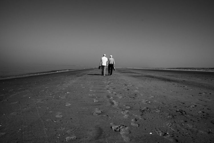 Barefoot Real People Beach Sand Rear View Two People Sea Clear Sky Men Outdoors Sky Shore Togetherness Water Landscape Landscape_Collection Nikon Full Frame D750 Blackandwhite Bw Monochrome Photography Barefoot Shoes Netherlands