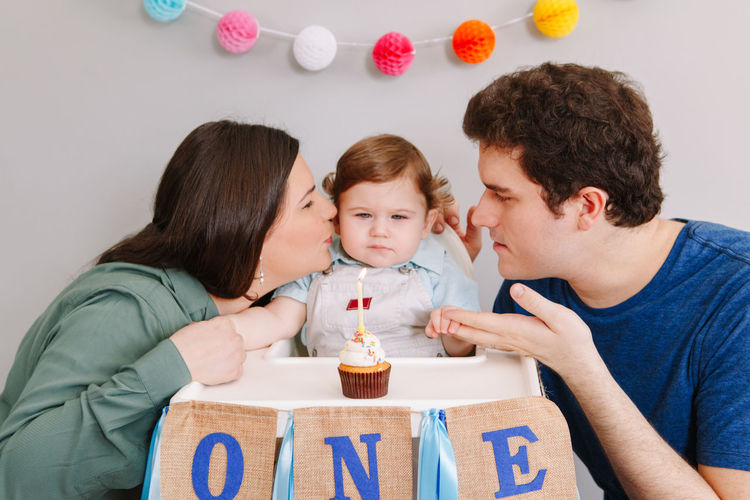 Cheerful family celebrating birthday at home