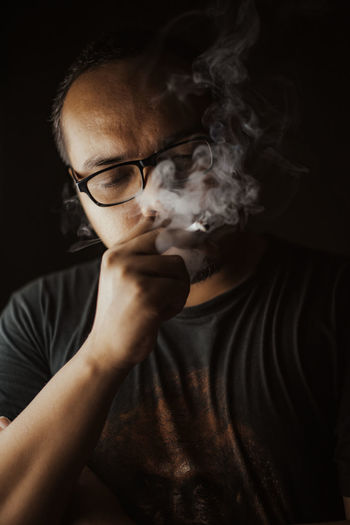 Portrait of a man doing smoking