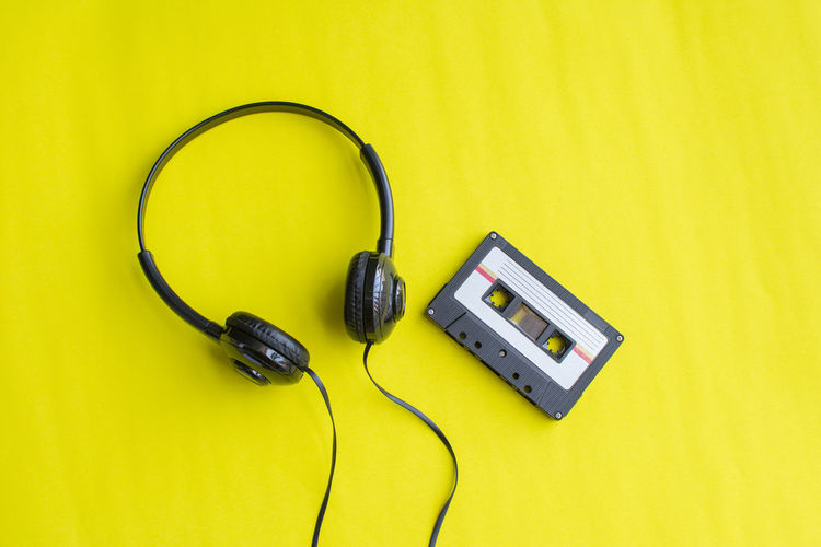 Retro Tape Cassette Old Vintage Technology Yellow Headphones Connection Listening Cable Indoors  High Angle View Music Still Life No People Electric Plug Colored Background Communication Yellow Background Arts Culture And Entertainment Close-up Electricity  Studio Shot Copy Space Power Supply