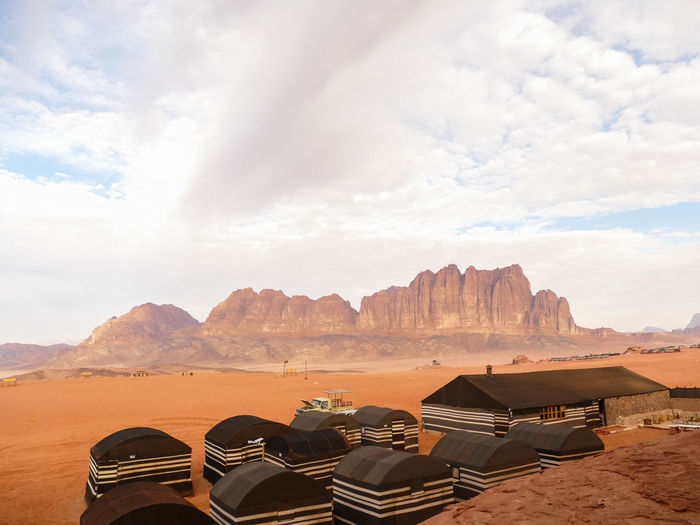 Panoramic view of desert against cloudy sky
