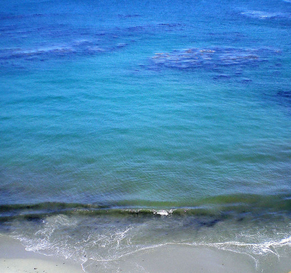 Blue turquoise water lapping a sandy shore along the California coast Aquatic Sport Backgrounds Beach Beauty In Nature Blue Blue Water Day Flowing Water High Angle View Motion Outdoors Scenics - Nature Sea Shoreline Sport Surfing Tranquility Turquoise Colored Water Waterfront Wave