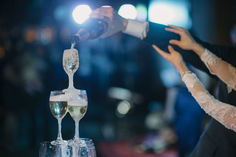bride and groom filled champagne fountain pyramid of glasses in the wedding ceremony. Champagne Glasses Wedding Alcohol Aniversario Close-up Drink Focus On Foreground Food And Drink Glass Glass - Material Glass Reflection Indoors  Party Pouring Refreshment Transparent Wedding Ceremony Wedding Party 😍😙 Wine