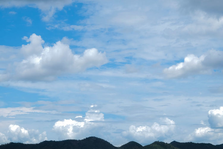 Low angle view of clouds over mountain