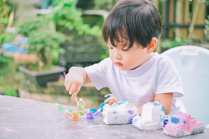 Cute boy playing with toy