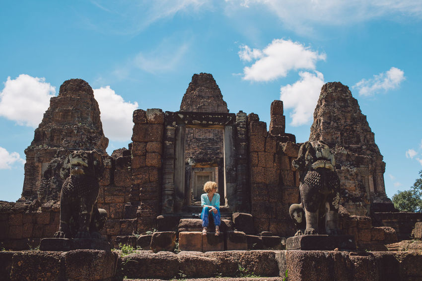 Siem Reap Cambodia Angkor Curly Hair Girl Architecture History Cloud - Sky The Past Sky Built Structure Ancient Real People Lifestyles Old Ruin Travel Destinations Place Of Worship Tourism Travel Spirituality One Person Leisure Activity Women Ancient Civilization Archaeology Ruined Outdoors