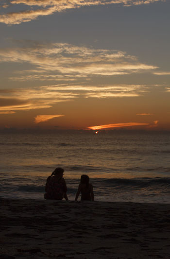 Beach Silhouette Horizon Over Water Two People Leisure Activity Togetherness Beautiful Taking Photos Summer Silhouette Streamzoofamily Photography Photooftheday Tadaa Community God's Beauty God Is Great.