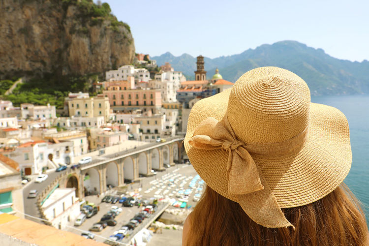 Rear view of woman wearing hat at amalfi coast