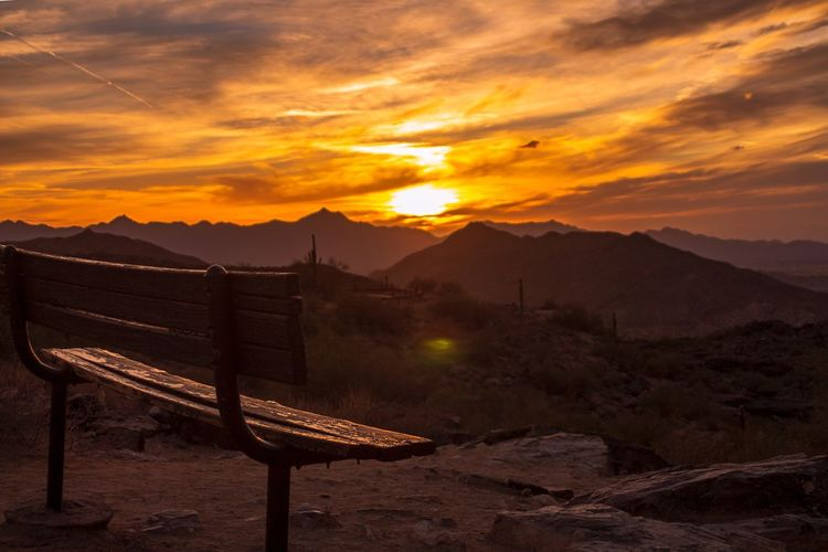 That bench i like Sonoran Desert Bench Park Bench Mountains View Arizona Sunset Mountain Sky Cloud - Sky Nature Landscape Environment Beauty In Nature Scenics - Nature Mountain Range Tranquility Sunlight Sun No People Travel Orange Color Land Travel Destinations Outdoors Tranquil Scene