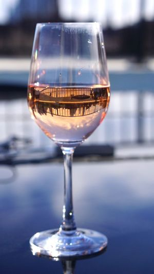 Rosé season has arrived Wine Drink Wineglass Close-up Drinking Glass No People Reflection Alcohol Focus On Foreground Refreshment Sky Table Brooklynnavyyard Rooftop Food And Drink