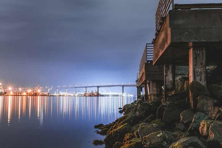 Architecture Bridge Bridge - Man Made Structure Building Building Exterior Built Structure Cloud - Sky Connection Dusk Illuminated Nature No People Outdoors Reflection River Rock Sky Transportation Water