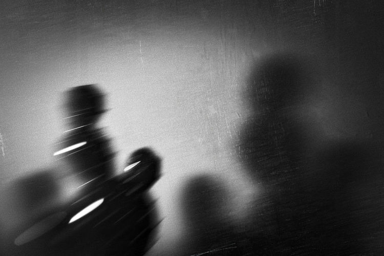 Blurred image of person shadow on wall