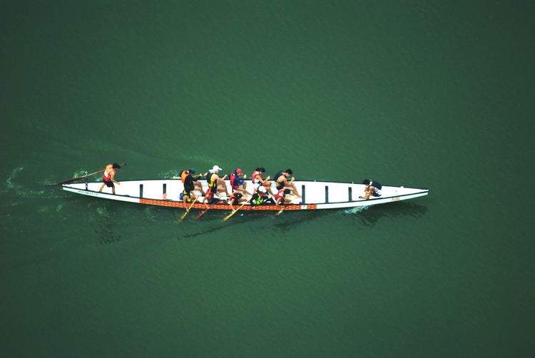 Kayaking Canoe Paddling Teamwork Sport Nautical Vessel Rowing Oar In A Row Sport Rowing Full Length Adults Only Rowboat Transportation High Angle View Coordination Togetherness Young Women Mode Of Transport Young Adult Cooperation Competition Medium Group Of People Aerial View Flying High View From Macau Tower