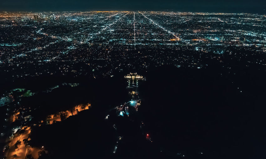 High angle view of illuminated highway in city at night