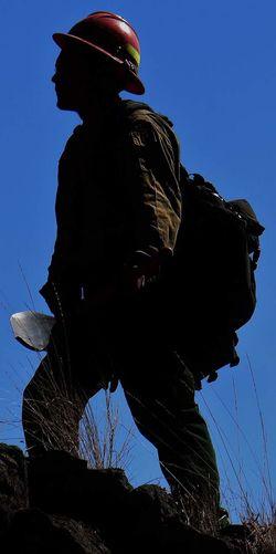 Half silhouette firefighter Silhouette One Person Outdoors Wildlandfirefighter Silhouette Contrasts Enjoying Life
