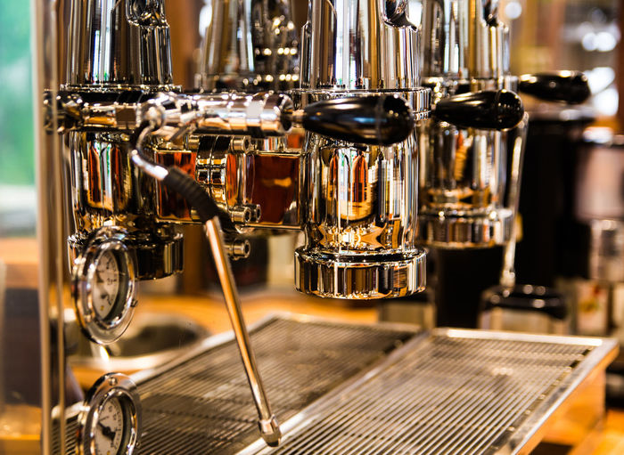 Coffee machine in the café Coffee Coffee Machine Bar Counter Brown Business Cafe Close-up Coffee - Drink Coffee Maker Coffee Shop Distillation Drink Focus On Foreground Food And Drink Indoors  Machinery Metal No People Refreshment Steel