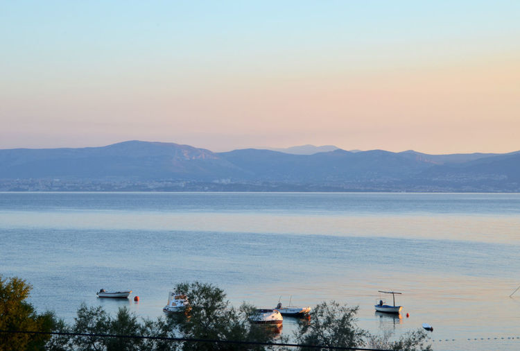 Morning view from Brač towards Split Beauty In Nature Boats Built Structure Clear Sky Day Mountain Mountain Range Nature No People Outdoors Scenics Sea Sky Sunrise Tranquility Tree Water