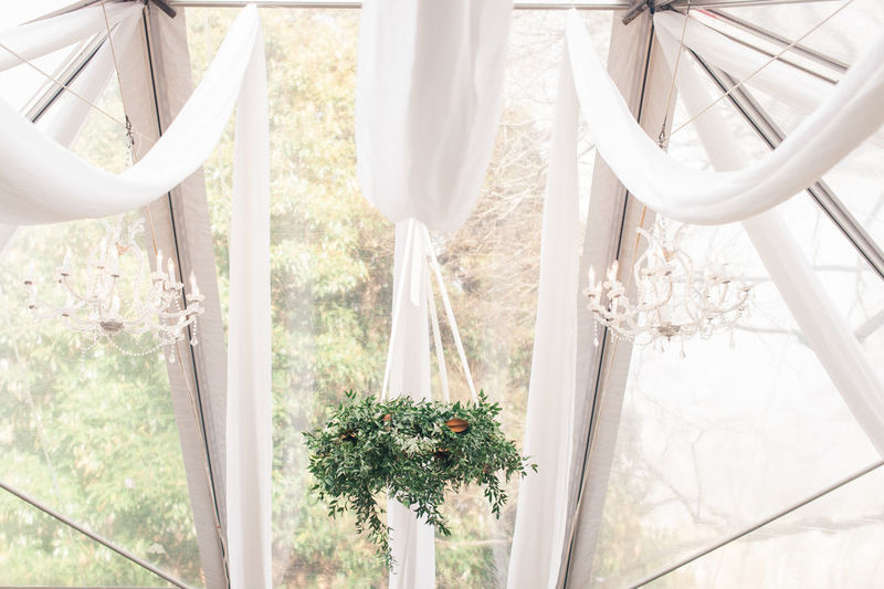 hanging lighting fixtures and florals in a clear tent with white drapery. Lighting Decoration Lighting Equipment Lights Wedding Wedding Photography Close-up Day Drapes  Floral Florist Flower Hanging Light Nature No People Outdoors Wedding Ceremony White Color