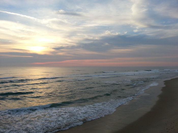 An Ocean of Beauty An Ocean Of Beauty Beauty In Nature Outdoors Scenic Sunrise Scenic Sunrise Over Ocean Shore Sky Beauty Sunrise