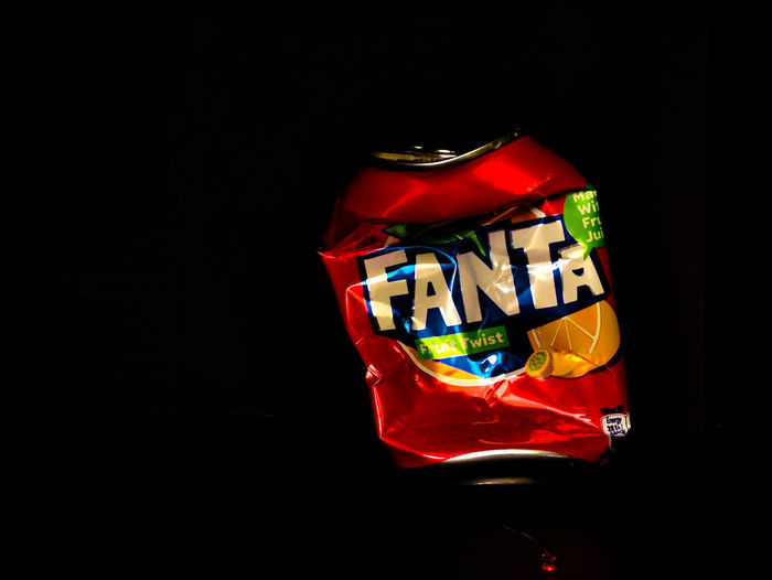 fanta Black Background Celebration Christmas Close-up Copy Space Cut Out Decoration Fanta Drink Gift Gift Box High Angle View Holiday Indoors  Multi Colored No People Red Shiny Silver Colored Single Object Still Life Studio Shot Transparent