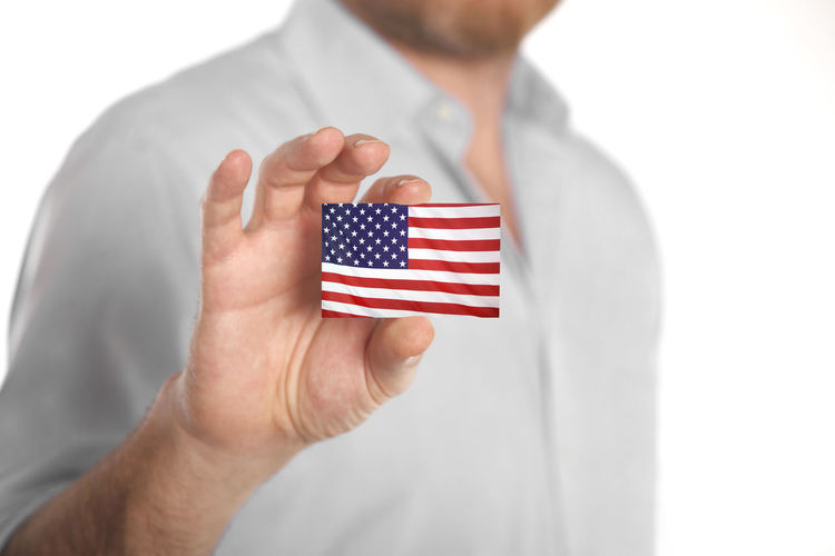 Flag Human Hand One Person Hand Patriotism White Background Striped Human Body Part Red Holding Studio Shot Men White Color Emotion Cut Out Close-up Indoors  Finger Democracy Menswear USA America American Flag