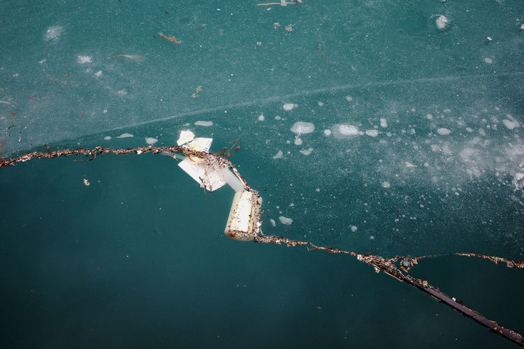 High angle view of debris and garbage on lake