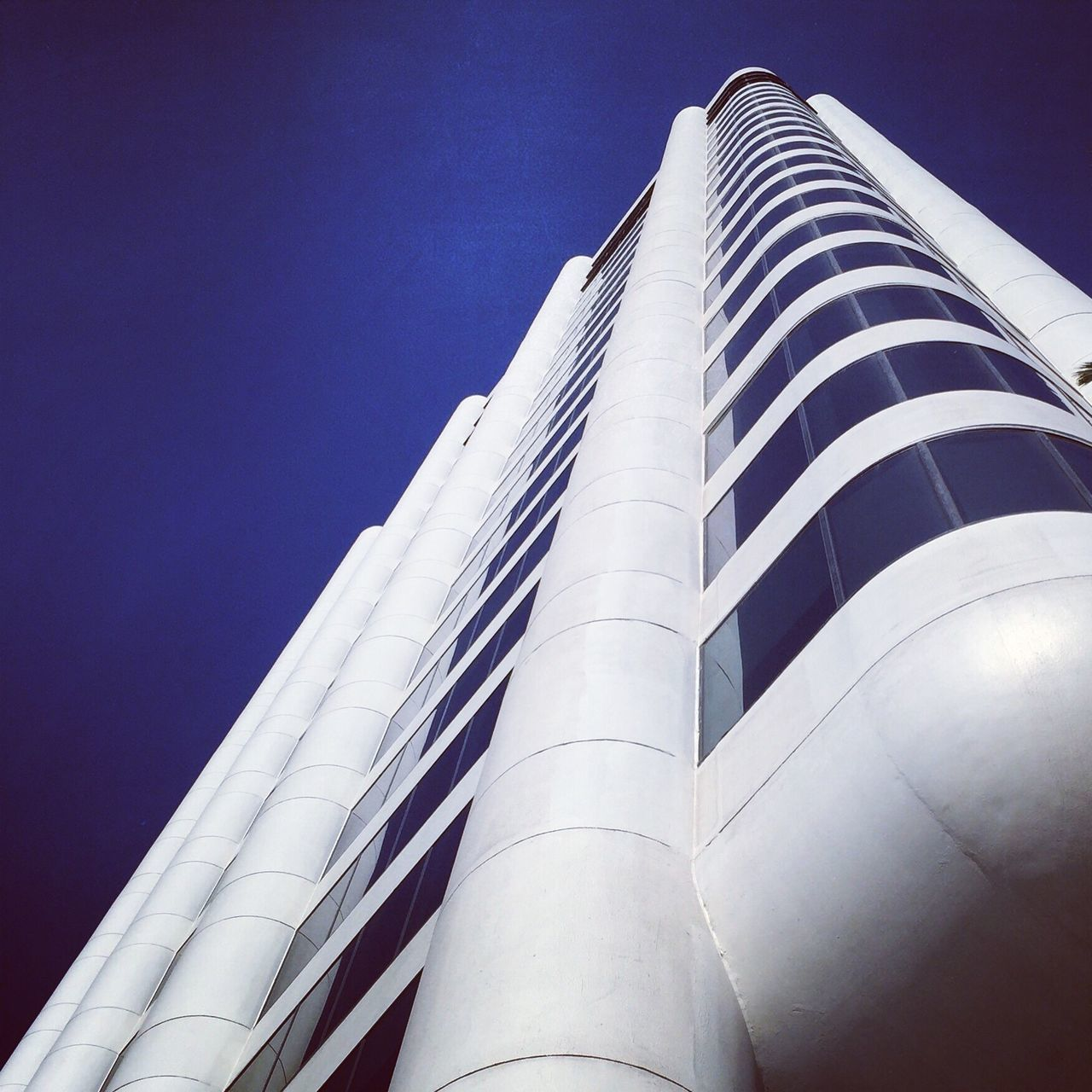architecture, built structure, low angle view, building exterior, modern, tall - high, skyscraper, no people, city, outdoors, day, travel destinations, tall, blue, sky, clear sky
