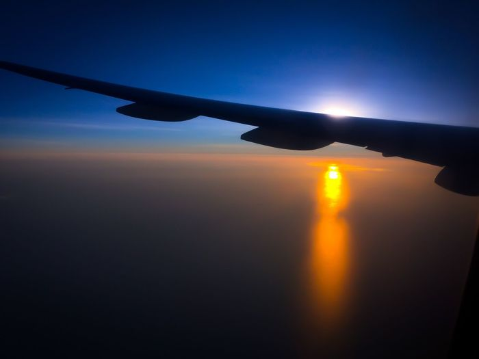 Airplane's view of the sunset- my favourite place, up above the clouds ✈️🌅 Airplane Flying Sunset Aircraft Wing Transportation Mode Of Transport Beauty In Nature Sky Airplane Wing Travel Sun Nature Air Vehicle First Eyeem Photo Ipadphotography My Favorite Place Sunset Silhouettes