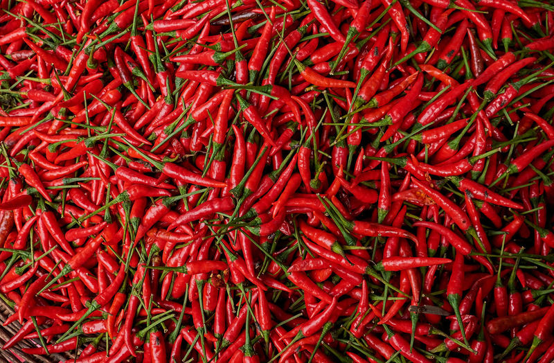 Full frame shot of red chili peppers at market for sale