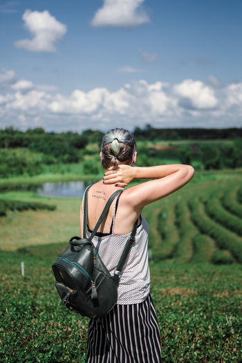 Chiang Rai, Thailand Tea Plantation  One Person Sky Field Land Nature Rear View Standing Real People Three Quarter Length Day Leisure Activity Plant Environment Landscape Women Focus On Foreground Cloud - Sky Sunlight Waist Up Outdoors Hairstyle Obscured Face
