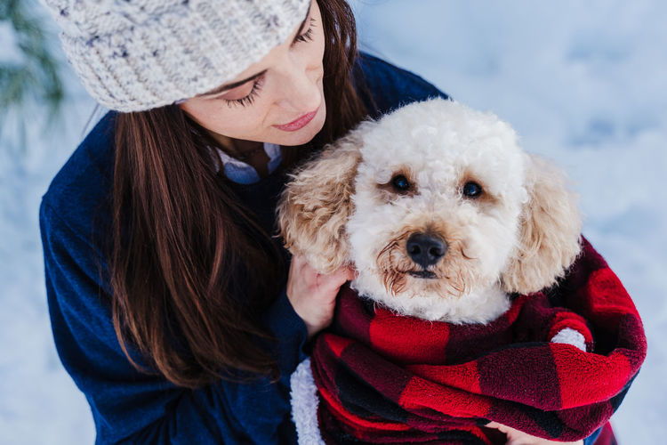 Woman with dog in park during winter