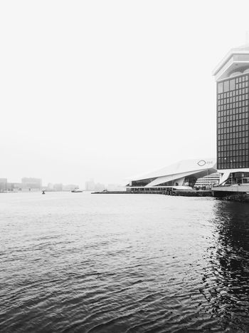 Adam. P122 Love this view in the morning when I'm on the ferry to work. Cold wind in my face. IPhoneography Onephotoaday 365project Cold Days Water Reflection River View Makemoments Amsterdam Vscocam Early Morning Eye Amsterdam Adam  Architecture On The Ferry On My Way Blackandwhite