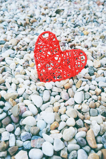 Solid Stone - Object Stone Rock No People Land Day Close-up Nature Red High Angle View Rock - Object Beach Beauty In Nature Outdoors Tranquility Gravel Heart Heart Shape Valentine's Day  Valentine's Day - Holiday Backgrounds Love Love ♥