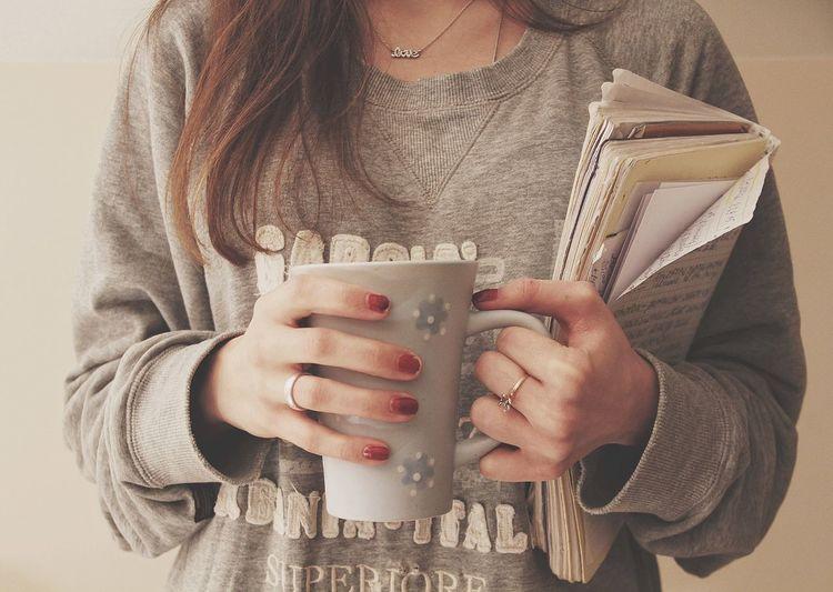 Close-up of hand holding mug