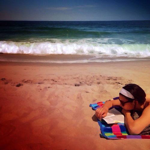Beach Read - she read quietly on a beautiful day at the beach....I mean at the 'shore'... the word we use here in Pennsylvania. Apps used #Snapseed #PaintFX #icolorama The Illusionist - 2014 EyeEm Awards The Explorer - 2014 EyeEm Awards The Moment - 2014 EyeEm Awards The Storyteller - 2014 Eyeem Awards #beach #read #ocean #beach #sand #clouds #sky #LBI #shore #water
