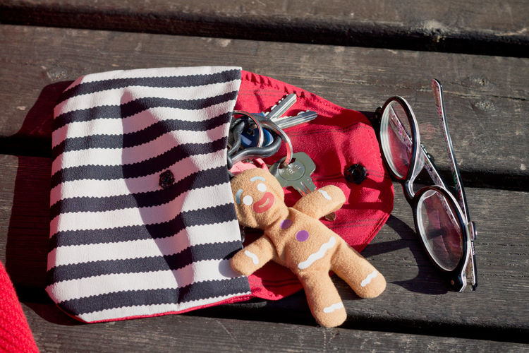 Acesories Object Photography Object Red Color Red Pochette  Ginger Gingerman Glasses Container Checked Pattern Large Group Of Objects Textile Shadow Day Striped Wood - Material Still Life Close-up No People High Angle View Bench Park Bench