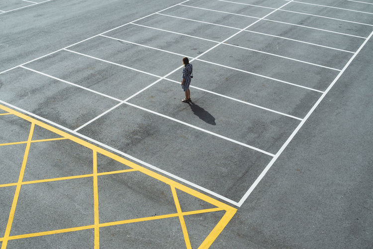 High Angle View Of Woman At Parking Lot