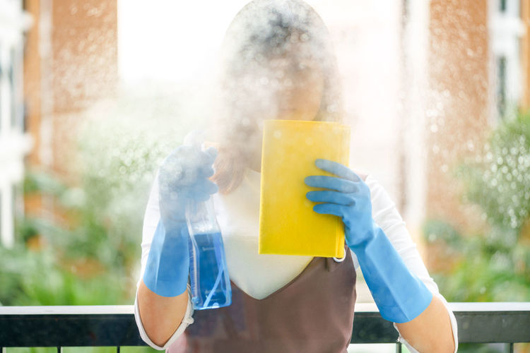 Woman Cleaning Glass Window